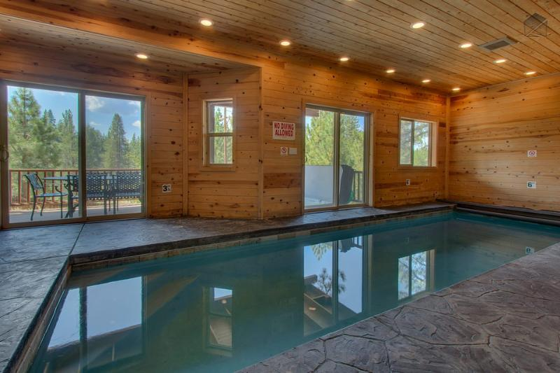 Take a dip in the private indoor pool downstairs and marvel at the magnificent views outside. - 7200 Sq. Ft. Home with Private Indoor Pool, Movie Theater, Hot Tub, Pool Table and more! - The Titan at Toiyabe - South Lake Tahoe - rentals