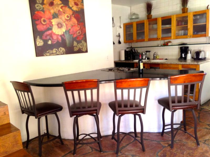 Kitchen, Bonus 3rd room off to the right, patio with seating for 4, sliding glass doors - Legendary Laurel Canyon Home in Hollywood Hills - Los Angeles - rentals