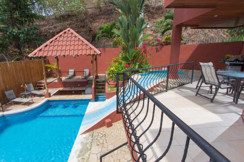 The pool with water slide and covered rancho - Casa Mirador-Fully a/c, Waterslide Pool & Views - Manuel Antonio National Park - rentals