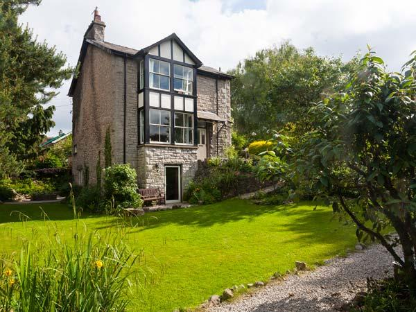THORNFIELD, detached, open fire and woodburning stove, WiFi, garden with - Image 1 - Arnside - rentals