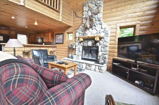 Spacious Livign Room with Queen Sofa Sleeper, 65 Flat Screen Television, Fireplace, and Wall of Windows. - 4BR Mountain Cabin - Skiers Paradise, Slope Side, Sleeps 13, Wood Burning Fireplace - Boyne Falls - rentals