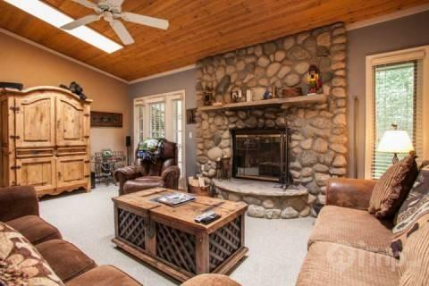 Enjoy relaxing by the fireplace after a day on the slopes in this cozy Living Room. - Meadow Creek Townhome F4 - Vail - rentals
