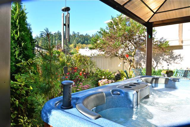 One of the summer garden views from the guest hot tub- yes it has a stereo.. - Serene Suite- Hot tub/Forest NR OCEAN- Castle too! - Victoria - rentals