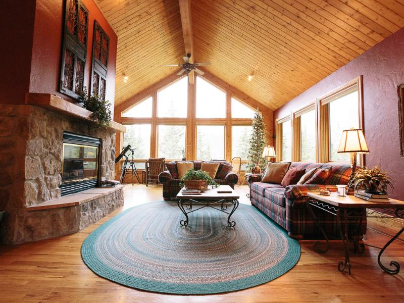 Main living area is very open with a wall of windows facing the mountain - Book Your Ski Vacation Now! - Breckenridge - rentals