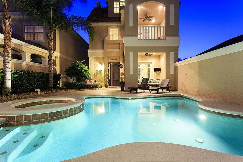 Magical Sunset Villa | Amazing Pool Villa with 2 Game Rooms, Slate Pool Table, 10 TVs throughout home and 3 Stories of Balconies with Amazing Views - Image 1 - Reunion - rentals