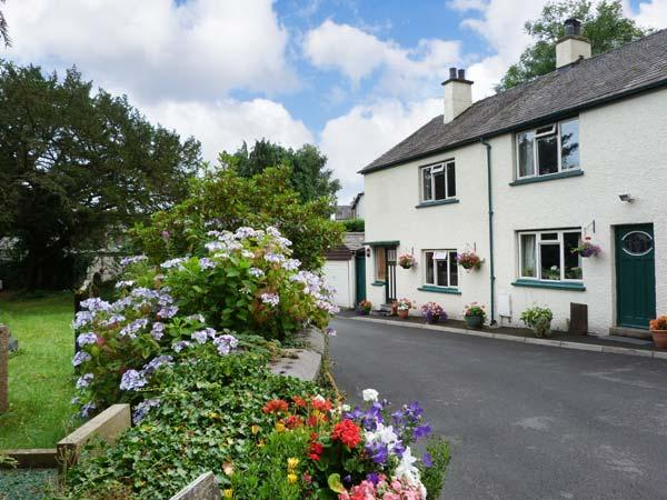 BRIDGE END, end-terrace, open fire, off road parking, decked patio, in Coniston, Ref 25666 - Image 1 - Coniston - rentals