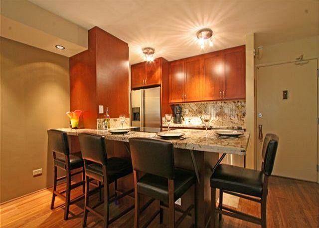 Wonderful gourmet kitchen with granite counter breakfast bar - Four Paddle one bedroom with gourmet kitchen, washer/dryer, WiFi and parking! - Waikiki - rentals