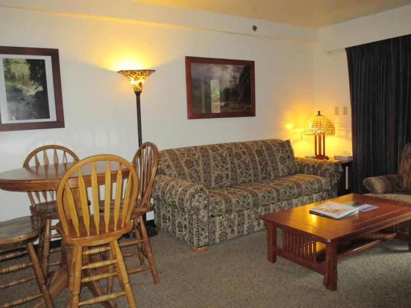 View of the condo dining & living area with queen size sofa sleeper. - Cozy Studio Condo Inside Yosemite Park! - Yosemite National Park - rentals