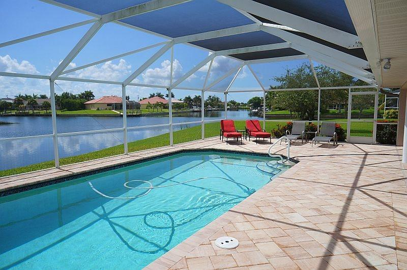 Blue Oasis - SW Cape Coral 3b/2ba Elect Heated Pool, Gulf Access Canal, HSW Internet, Boat Dock, 2 kayaks with small lift, 2 bicycles - Image 1 - Cape Coral - rentals