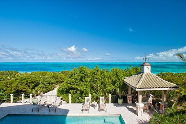 Located on the western end of Grace Bay Beach, this villa is nestled amid cloistered decks. TNC TAM - Image 1 - Grace Bay - rentals