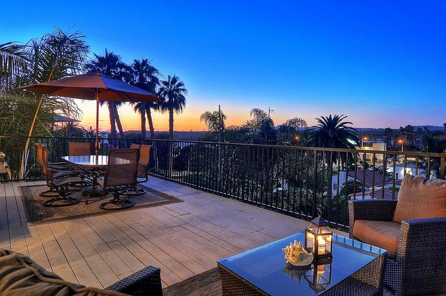Outdoor dining and lounge chairs outside of living room - Steps to North Beach, near SC Outlets, & more! - San Clemente - rentals