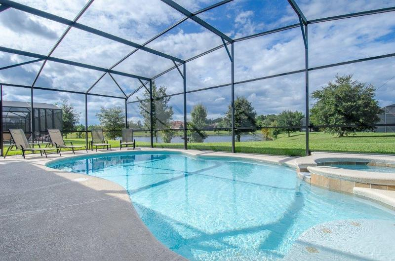 CALABRIA -5 bed/4ba HOME SB - South facing Extraordinary POOL/SPA/GAME ROOM/GRILL- 5 miles to Disne - Image 1 - Four Corners - rentals