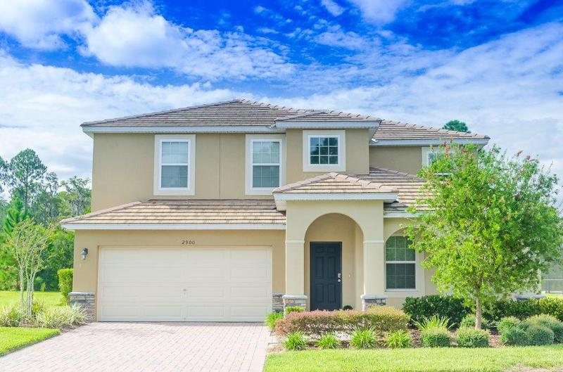 2900 CALABRIA -5 Bed/4.5 bh- Luxurious Lifestyle! 2 Story Amazing  Pool Home, spa, game room, Lake - Image 1 - Kissimmee - rentals