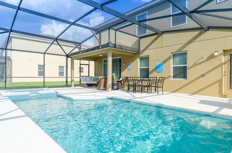 CALABRIA -5 Bed/4.5 ba- MF Luxurious Lifestyle! 2 Story Amazing  Pool Home, spa, game room, Lake - Image 1 - Kissimmee - rentals