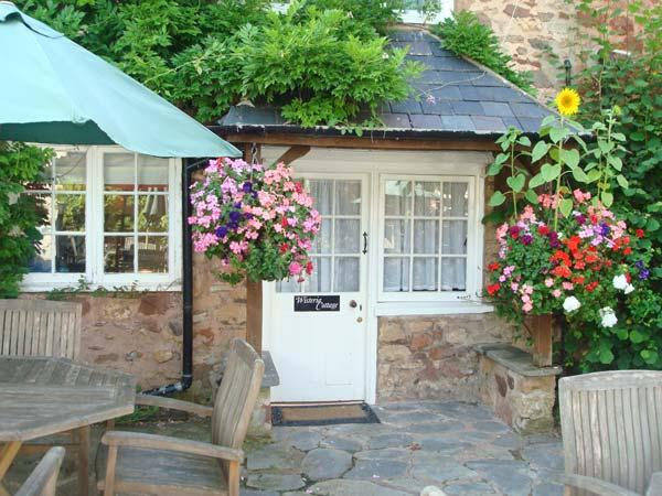 WISTERIA COTTAGE, semi-detached, WiFi, pet-friendly, beaches close by, near Dunster, Ref 25293 - Image 1 - Dunster - rentals