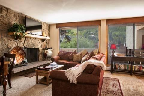 Open living area features wood burning fireplace and mountain slope views. - Scorpio 206 - Vail - rentals