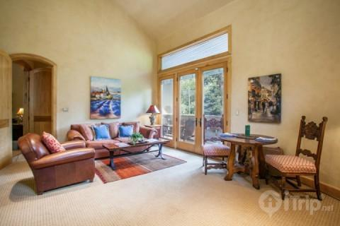 Beautiful European style living room, french doors opening to scenic Gore Creek and dining table for 2. - Glen Falls 1 Bedroom Apartment - Vail - rentals