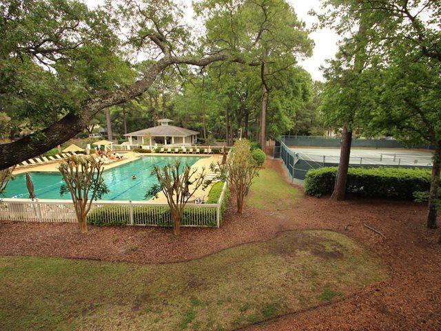 View of pool and tennis courts - Fiddler's Cove, 25D - Hilton Head - rentals