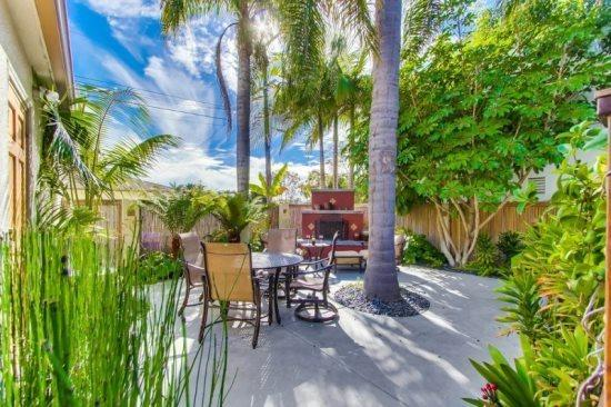 The back cottage patio with fireplace, and dining  - Krystin's Beach Cottage - with a patio fireplace - Pacific Beach - rentals