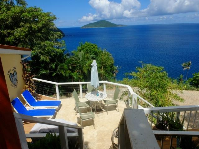 Lounge and dine on your coaral stone deck - Funky-Luxury-Cliffside-Private Cottage - Peaceful - Saint Thomas - rentals