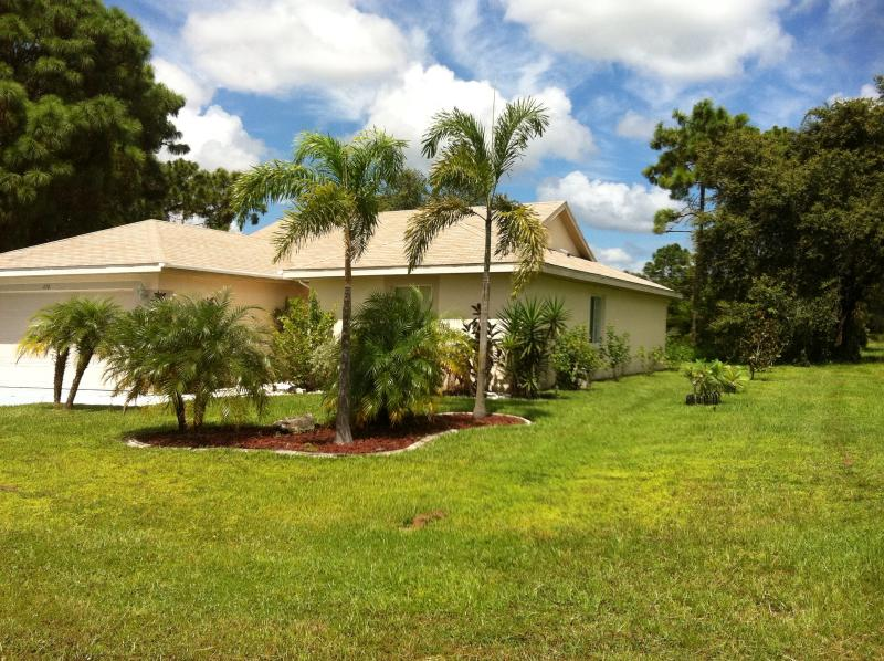 Front view of the house, corner lot. - Pool Home! Beaches, Golf, Shopping! - Rotonda West - rentals
