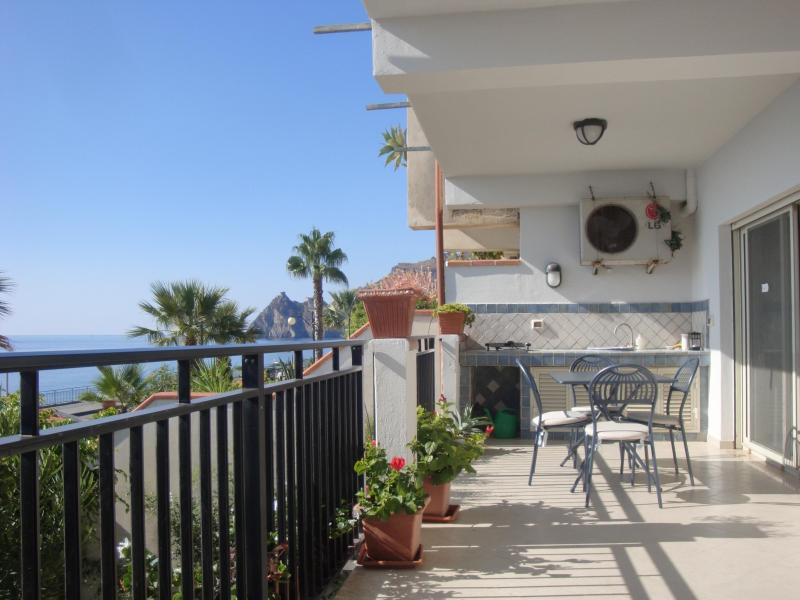Spacious sea-facing terrace with grill, dining and sitting areas, views of Medieval castle and Italy - Taormina SEAFRONT BEACH home with terrace - Sant' Alessio Siculo - rentals