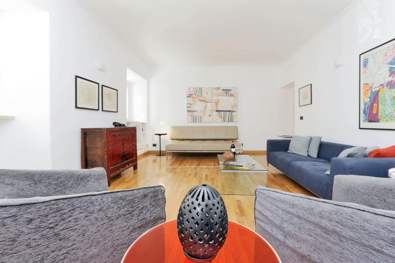 Spacious and elegant living room, with three windows for natural light. - The Spanish Steps Apartment - Free Airport Pickup! - Rome - rentals