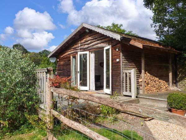 WOODMANCOTE LODGE, pet-friendly romantic lodge with Sky, WiFi, swimming pool, sauna, Linchmere Ref 916403 - Image 1 - Fernhurst - rentals