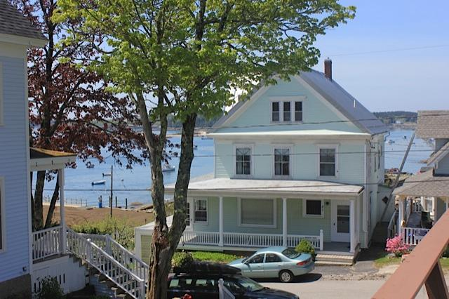 Exterior front of home with ocean in the back - Harbor View House - Large, Oceanfront In-town Home - Stonington - rentals