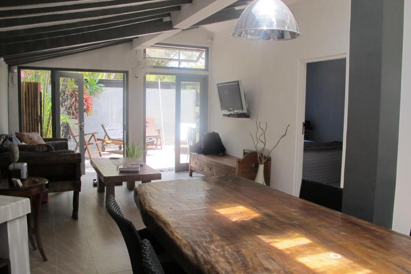 Air conditioned living room and kitchen, wall TV cable, large sofa, huge dining table - La Maisonnette Sanur beach walk Perfect 1bdr house - Sanur - rentals