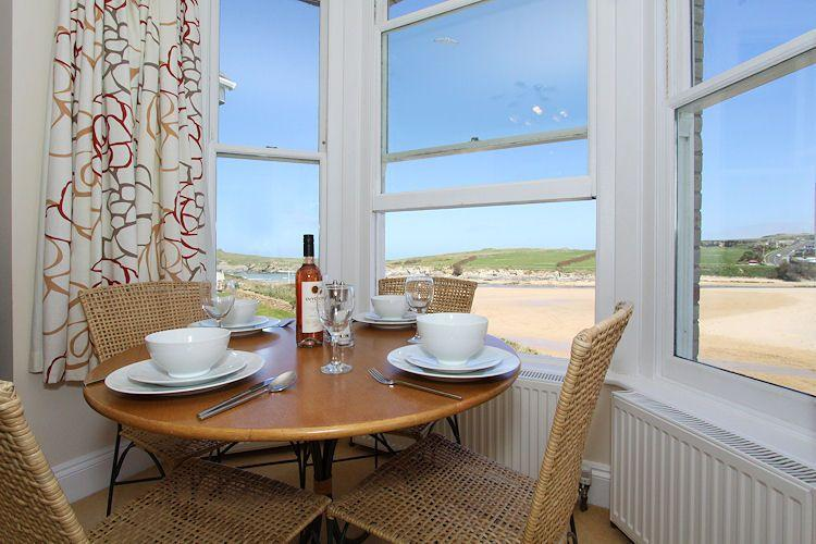 Living area with views over Porth Beach - 4 Seashore located in Newquay, Cornwall - Newquay - rentals