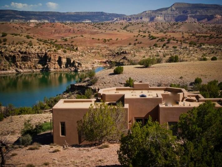 A view of The Casita from the mesa top up above...overlooking Abiquiu Lake and the red rocks. - New 7/11-16 opening! Luxury Abiquiu Lakefront Home. 22 acres, WIFI, A/C, HotTub - Abiquiu - rentals