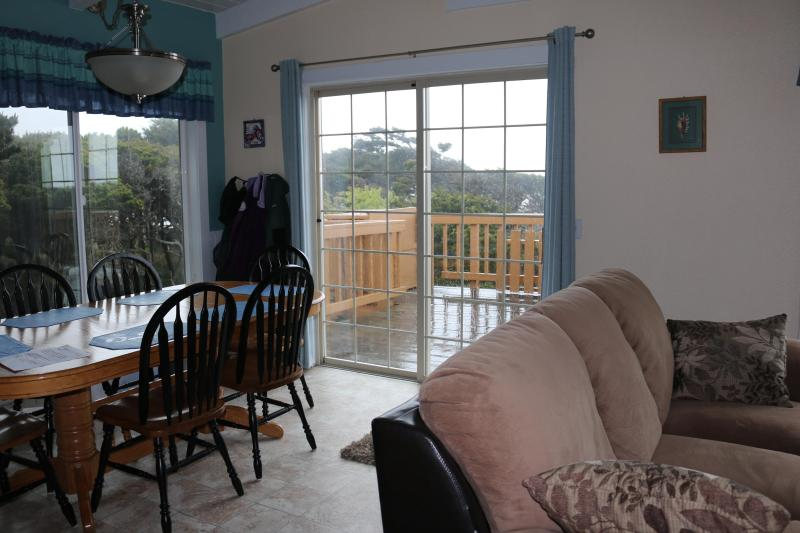 view out to deck and ocean beyound - OurSandDollar: ocean view and easy beach access - Yachats - rentals