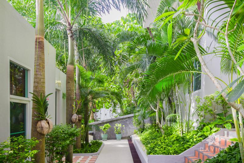 Greenery garden view that is comforting to the eyes from apartment terrace view - Loft Retreat in Panwa! Twin Beds, Pool, Beachfront - Cape Panwa - rentals
