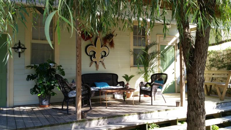 Covered back porch, with original art celebrating the Saints 2009 Super Bowl victory! - HISTORIC BYWATER VACATION HOME - NEW ORLEANS - New Orleans - rentals