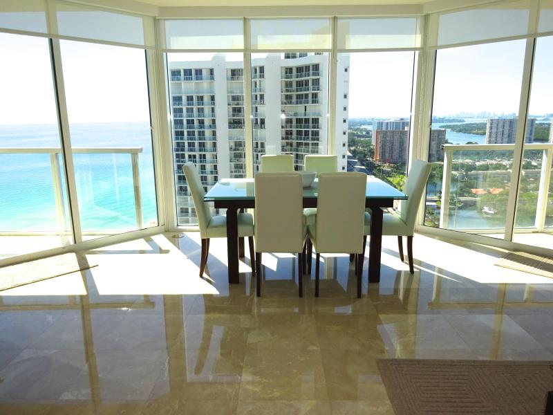 Living Room - Floor to ceiling windows - SUNNY, MODERN CORNER! MASSIVE WRAPAROUND BALCONY! - Sunny Isles Beach - rentals