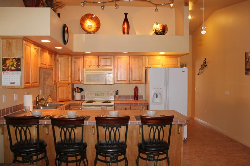Kitchen with seating for 4 - Modern Elegance; Beautifully Designed 1 Bd Condo - Saint George - rentals
