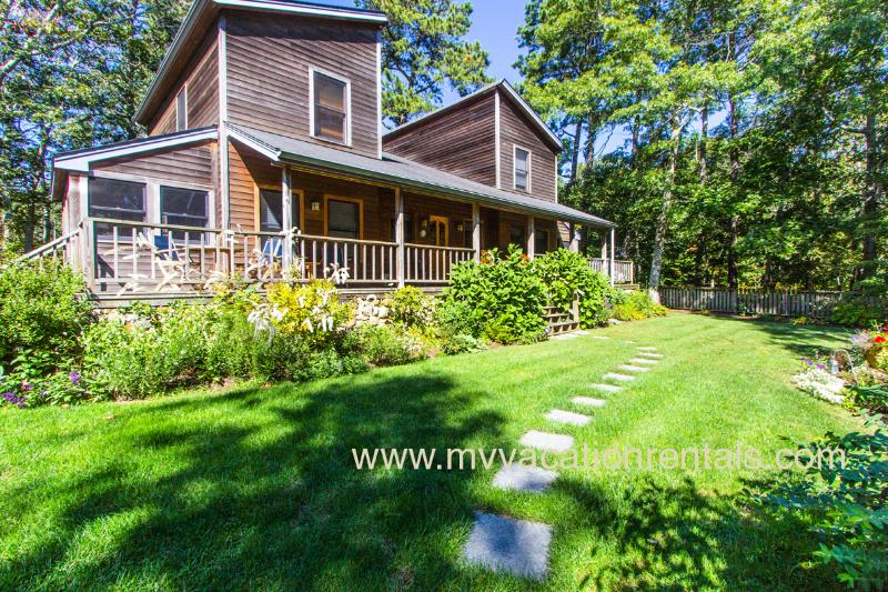 Yard and Front of House with Expansive Porch - ARMSL - Beautiful Contemporary Home, Private Landscaped Yard, Children's Play Area, Large Veranda, Wireless Internet - Vineyard Haven - rentals