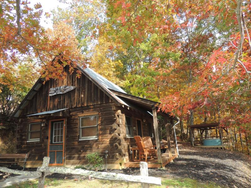 Enjoy the covered front porch with rockers and a swing. - Romantic 1 Bedroom Log Cabin - The Cathey Cabin - Bryson City - rentals