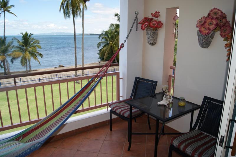 bistro set, hammock and beach - Haciendas del Club beachfront 1-305 1 br w/WiFi - Cabo Rojo - rentals