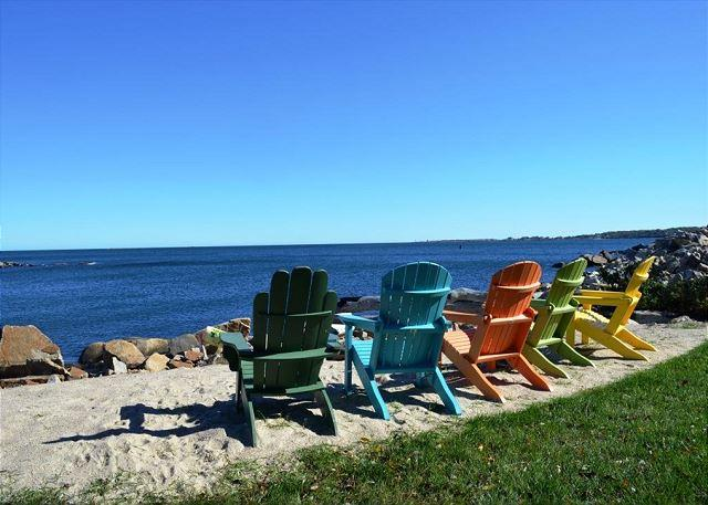 A waterfront fire pit and colorful chairs make sitting by the wa - Sunrise on the Cove: Unobstructed 180 degree views of Pigeon Cove - Rockport - rentals
