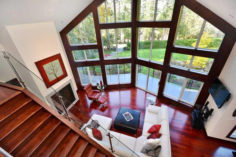View of living room from loft - Luxurious 3 Bedroom Upper Executive Home Near Sidney - Sidney - rentals