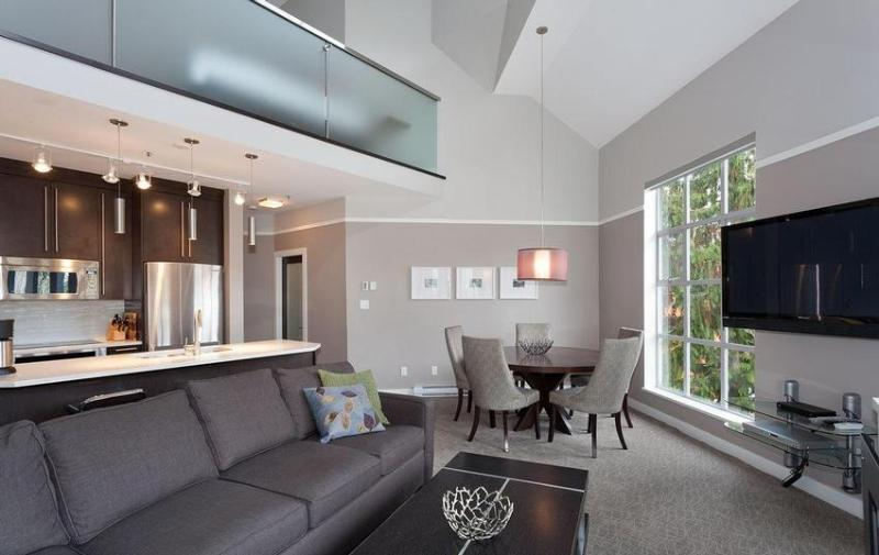 Living Area: newly renovated property, heated floor, large screen TV, private deck, great mountin views, modern kitchen, and much more! - Whistler Ideal Accommodations: Deluxe 2 bedroom plus loft ski in ski out - Whistler - rentals