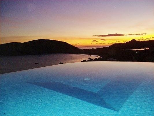 Sunset from infinity edge pool, Ocean Song Villa. - SPECIAL 2 FOR 1  Luxury Villa & Beach Front Lounge - Turtle Beach - rentals