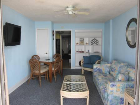Remodeled livingroom area with LCD Television and new paint - Palms 1605 Gorgeous View of the Grand Strand - 1-bedroom Oceanfront condo - Myrtle Beach - rentals