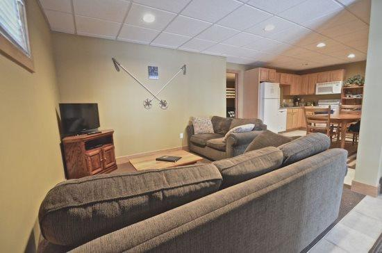 Spacious Living Room with Flat Screen TV - Cozy Two Bedroom Condo Located in Disciples Village, Close to the slopes and the village of Boyne - Boyne Falls - rentals