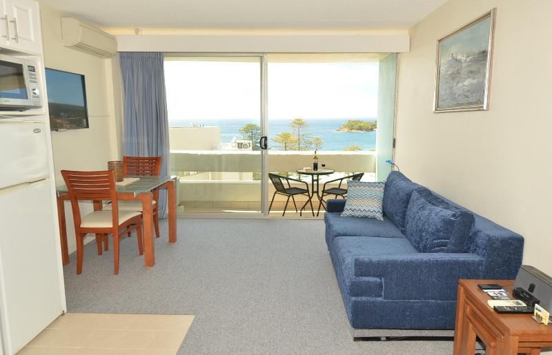The air-conditioned living area provides a relaxing space with a brilliant view - Manly Seaside Bliss - Manly - rentals