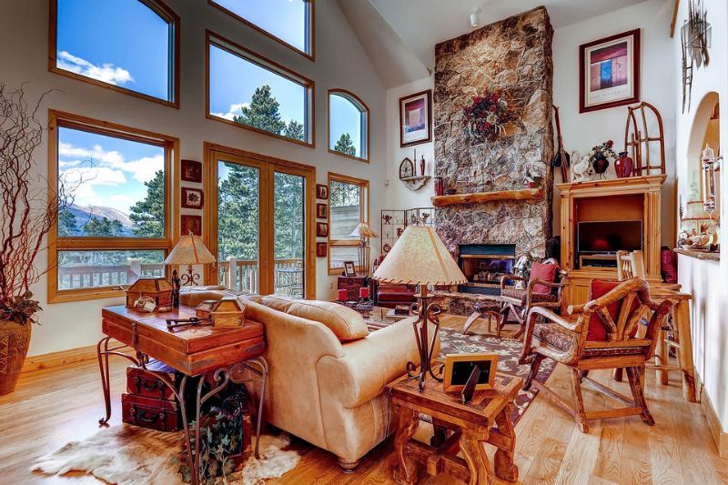 Open plan living room with gas fireplace, flat screen TV, access to deck, and views. - Game room, free shuttle, ski area views! (game room, free shuttle, ski area views) - Mountain High Retreat - Breckenridge - rentals