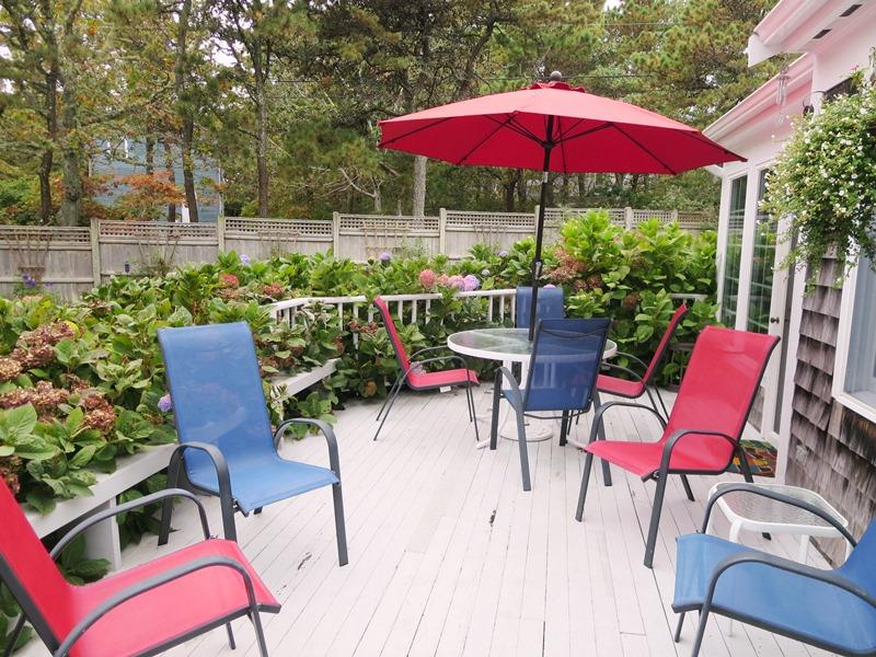 Outdoor deck with plenty of seating, table, umbrella and charcoal grill - 58 Longs Lane Chatham Cape Cod - Chatham - rentals