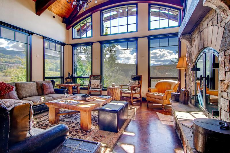 This great room not only has great views, but also has a gas fireplace and a surround sound audio system. - Fun and games. And golf. Private hot tub, golf course nearby - Tomboy Retreat - Mountain Village - rentals